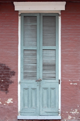 Shuttered French doors on an unrestored Creole cottage in the French Quarter